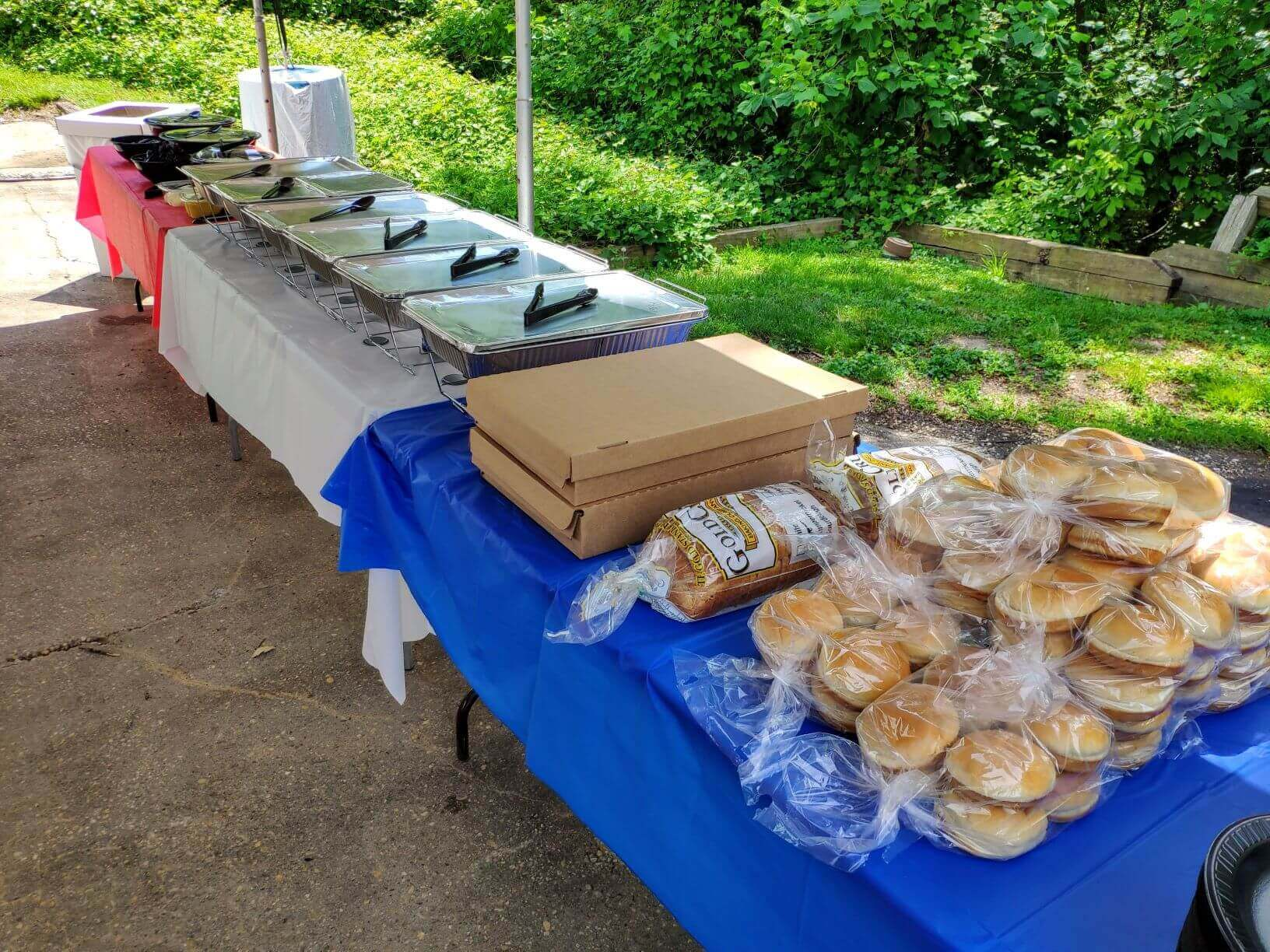 Hot Food Catering displayed on a table outside
